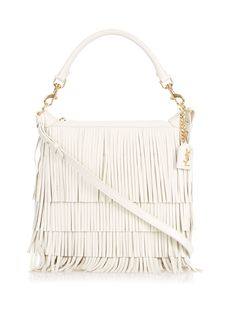 Saint Laurent's white leather Emmanuelle bag is the freshest way to work the new season's retro influence. Tiers of fringing decorate the front while slicks of gold-tone metal bring instant polish. Retain the 1970s vibe by wearing it over the shoulder of a tan-brown suede biker jacket. Available now at #MATCHESFASHION.