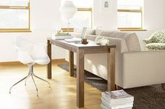 putting a desk with a chair behind a couch is a great way to add office space in a small space