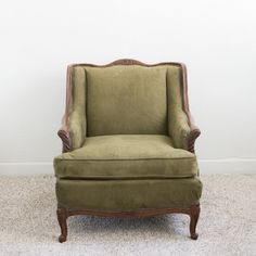 Elroy Chair: Elroy's a bold and fearless man. While he's soft around the edges with his gorgeous wood frame, his velvet olive upholstery balances him out well.