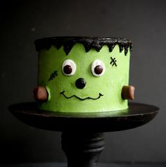Fun and playful Frankenstein Layer Cake! This delicious cake is pretty darn easy… just some food color and some decorating tips (and of course lots of candy) and you are all set! And yes, if you follow my LIVE facebook video's, you will remember when I made this on Oct. 4th! To make this cake...