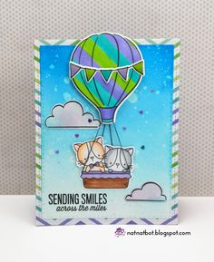 Sending smiles across the miles. These cute kittens riding in a hot air balloon is spreading their cuteness to everywhere they travel. Features stamps from the MFT Cool Cat set and Lawn Fawn's Blue Skies.
