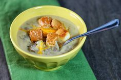 This Cheeseburger Soup is warm, hearty and cheesy and even has cute hamburger bun croutons! Great recipe for the whole family. Each serving is just 259 calories or 7 Weight Watchers points! www.emilybites.com