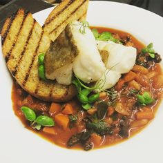 Come in and warm yourself on a cold November evening.  #merluzzo  #cod fillet served with a #hearty #Tuscan #beanstew and #fennelcrostini