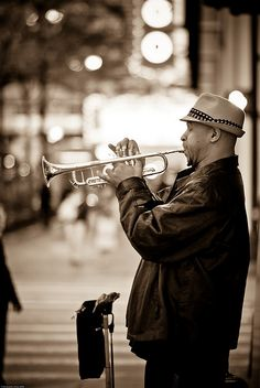 Small world!!! So I went on a photo walk one day and stuck to the loop south of the Chicago river. I was walking north on State St. and came across a gentleman playing a trumpet. We ended up being friends. Come to find out a good friend from college was his cousin. AND he just used this photo for his album cover.
