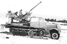 A SdKfz 7/2 armored cab halftrack with 37mm Flak 37  operating in winter conditions