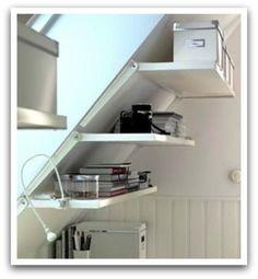A slanted wall shelving unit for slanted walls at ikea: Ekby Riset adjustable brackets and shelves. Attic Renovation, Attic Remodel, Basement Renovations, Attic Storage, Storage Spaces, Camper Storage, Attic Spaces, Small Spaces, Office Spaces