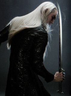 Picture of Thranduil with sword, from the Art of War book.