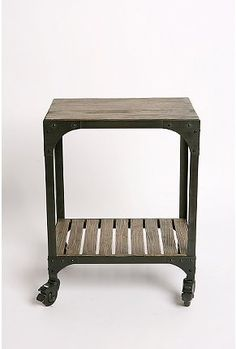 This would be a perfect bar cart! (Industrial Rolling Side Table - $169 @ Urban Outfitters)