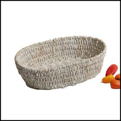 """Our Whitewash Oval Basket is the perfect solution for both indoor and outdoor entertaining. Handcrafted Seagrass items are 100% environmentally friendly.   Handcrafted in the Philippines  Size: 13"""" x 8"""" x 3 1/2"""""""