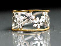 Anillo de flores bicolor-plata esterlina
