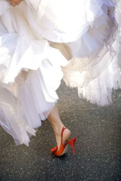 love the idea of a red heel underneath an amazing wedding dress for a wedding in italy..