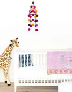 - Description - Artisan Transform your nursery with this decorative crib mobile…