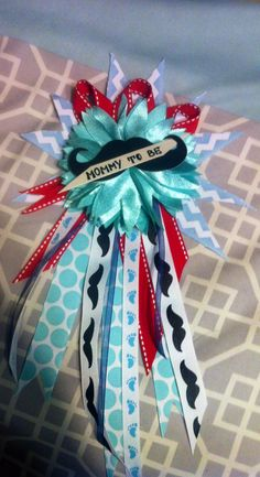 baby boy shower corsage- good use of the extra mustaches!