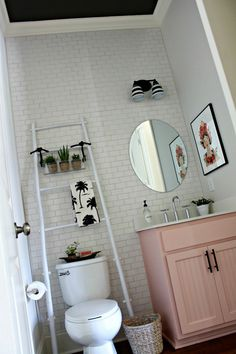 Urbane bronze on the ceiling makes this small windowless bathroom feel larger - powder bathroom makeover - Our Fifth House