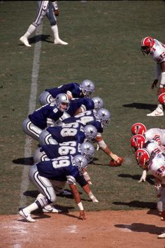 Quarterback Troy Aikman of the Dallas Cowboys sets the offense against the Atlanta Falcons in an NFL game at the Fulton County Stadium on September...