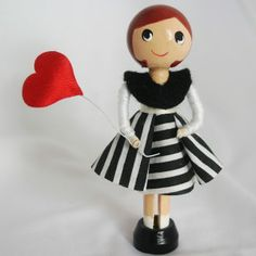 Cute little clothes pin doll holding her heart shaped balloon....... £12.00 + free postage to Uk by Troodlecraft