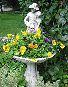 Flowers in a fountain or birdbath...great idea!