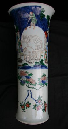 Transitional wucai beaker vase, circa 1640, decorated with a group of men scrubbing and washing a large elephant as others look on, the lower portion with branches of flowering peony, chrysanthemum and lotus, the mid-section later incised with a four-character vertical Tibetan-style inscription to one side and incised lotus growing from a rock on the opposite side, height: 10 1/8in. 51cm