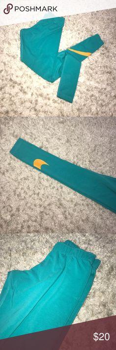 Nike legasee leggings Real Nike legasee leggings, orange Nike swoosh. Worn maybe twice, in excellent condition! Nike Pants Leggings