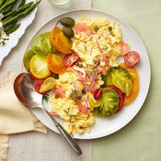Lox Scrambled Eggs Recipe: Soft scrambled eggs, cream cheese, capers, smoked salmon and tomatoes.