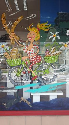 The Tour de France started in this region this year (at Mont St. Michel) a source of great pride for the locality. In my local town, Percy, Basse-Normandie, all the shops had their windows painted with a cycling motif representing the activity carried out by the shop concerned.= Bakery