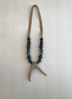 A personal favorite from my Etsy shop https://www.etsy.com/listing/484119100/double-point-deer-antler-necklace