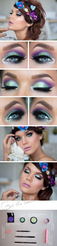 Aqua / green eyeshadow on the lid, purple in the crease, cat eye.