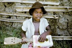 Boy plays with home made guitar Plays, South Africa, Guitar, Homemade, Colour, Games, Color, Home Made, Guitars
