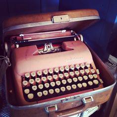 Vintage pink typewriter. That's great!
