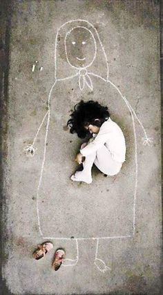 Heartbreaking image by an Iraqi artist taken in an orphanage. This little girl has never seen her mother, so she drew a mom on the ground and fell asleep with her. Heart wrenching to be so alone from the inception of life. I pray God will provide her a home filled with love and a mother she can hold and call her own.