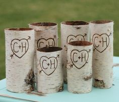 Cover coffee cans, Pringles containers, etc. with birch colored paper. The perfect DIY project for a rustic style wedding.