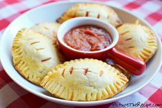Pizza is a party staple, and Picture the Recipe's pizza pockets are perfect for game day. Stuff these creations with an assortment of veggies and meats for a dish that pleases everyone.   Source: Picture the Recipe