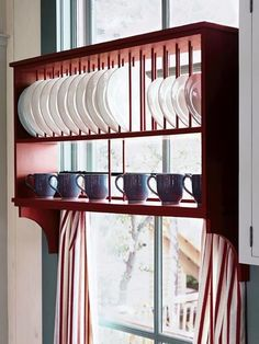 Who would have thought window treatment  storing dishes could be one-and-the-same? I love the striped curtains that link the dish rack. Sweet!