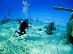 Underwater photography . Shooting the shipwreck Tibbetts. Cayman Brac scuba diving.