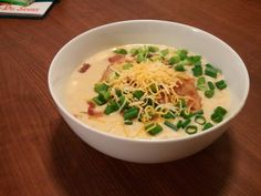 crockpot cheddar potato soup topped with bacon and green onions.