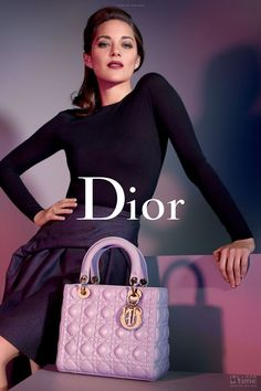 Marion Cotillard poses for Lady Dior ads