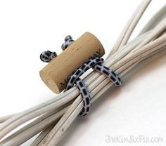 DIY cord ties made from a wine corks and bungee cords.  A great reusable way to tie up and organize extension cords, or garden hoses etc. #TheKimSixFix