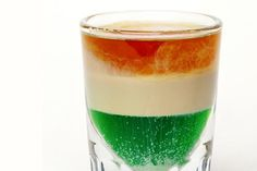 Shooter recipe for an Irish Flag, a layered shot of creme de menthe, Irish cream, and orange liqueur that resembles the flag of Ireland.