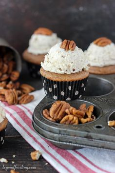 These Maple Pecan Cupcakes are the perfect fall cupcake. It's a spiced maple Cupcake with a brown butter pecan frosting.
