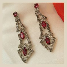 "Vintage Earrings old Hollywood rhinestone Amazing vintage 1940s earrings Pierced posts Sparkly clear and ruby red glass rhinestones are prong set in Silver tone metal These are large,  long, dramatic earrings. I can imagine these worn in a Christmas Wedding. Excellent condition Measures 2.5"" long   Inventory owl00511Ruby888 Vintage Jewelry Earrings"