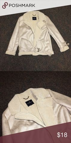 Moto Style Faux-Fur Lined Winter Jacket Very gently used tan winter jacket. It's very warm and faux-fur lined. There are buckles on the sleeves and around the bottom of the coat and it has two pockets. The coat is a faux suede moto jacket. American Eagle Outfitters Jackets & Coats