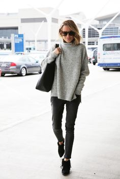 272ebd396be Airport Style Round Sunglasses Comfortable Turtleneck Sweater Cropped Skinny  Jeans Croc Tote Fringe Booties Via Anines World