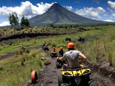 Mayon is an active stratovolcano in Albay, Philippines. While the volcano can be climbed, you can also take an ATV tour and ride along its rugged terrain.