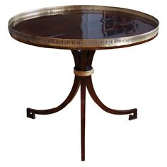 Early 19th Century Round Empire Center Table with Brass Pierced Gallery | From a unique collection of antique and modern center tables at http://www.1stdibs.com/furniture/tables/center-tables/