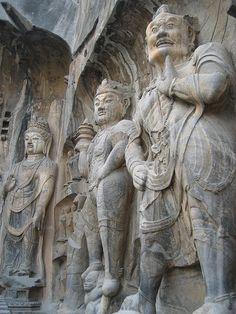 Rock-carved statues at Longmen Caves in Henan,...