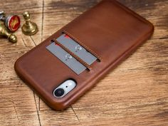 Welcome to the shop. The product is 100% Genuine Leather. The color of the product is brown. Handmade phone case is made of premium quality genuine leather. This wallet case fit for iPhone XR Extremely lightweight. Will be more smooth and shiny as time passes by Iphone Leather Case, Iphone Wallet Case, Iphone 7 Plus Cases, Leather Wallet, Phone Case, Brown Band, Apple Watch Bands, Smooth, Fit