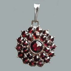 Bohemian Garnet - (My birthstone and my favorite color...if I ever go back to Prague, I'd love to find something that looks like this.)