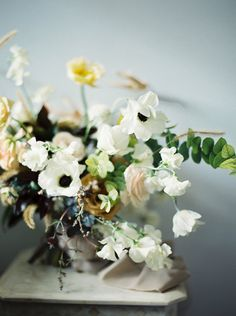 green, pale peach, white and pale yellow wedding flowers
