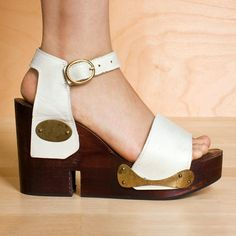 white leather and gold metallic accent with dark wood platforms