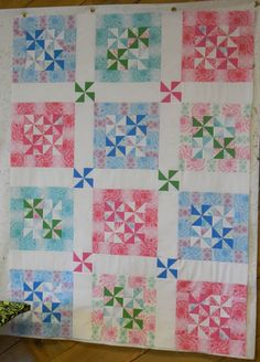 I like this pinwheel quilt.  Usually the pinwheels are all over and a little distracting...but I really like the way this is set up.